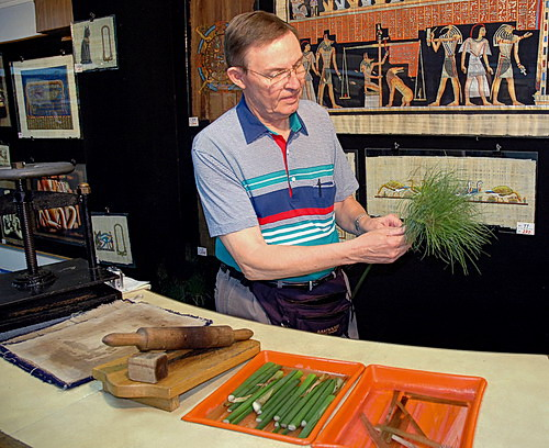 Ferrell Jenkins shows how papyrus plants are cut to make writing mateial.