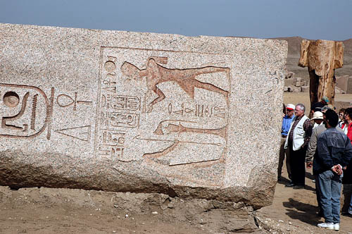 Group views large stones with Hieroglyphs at Tania, Egypt. Photo by Ferrell Jenkins.